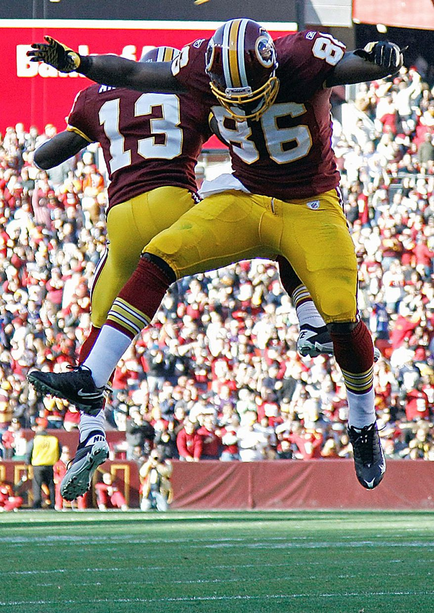 Washington Redskins tight end Fred Davis, right, celebrates his touchdown with teammate wide receiver Anthony Armstrong (13) during the first half of an NFL football game against the Minnesota Vikings in Landover, Md., Sunday, Nov. 28, 2010. (AP Photo/Evan Vucci)