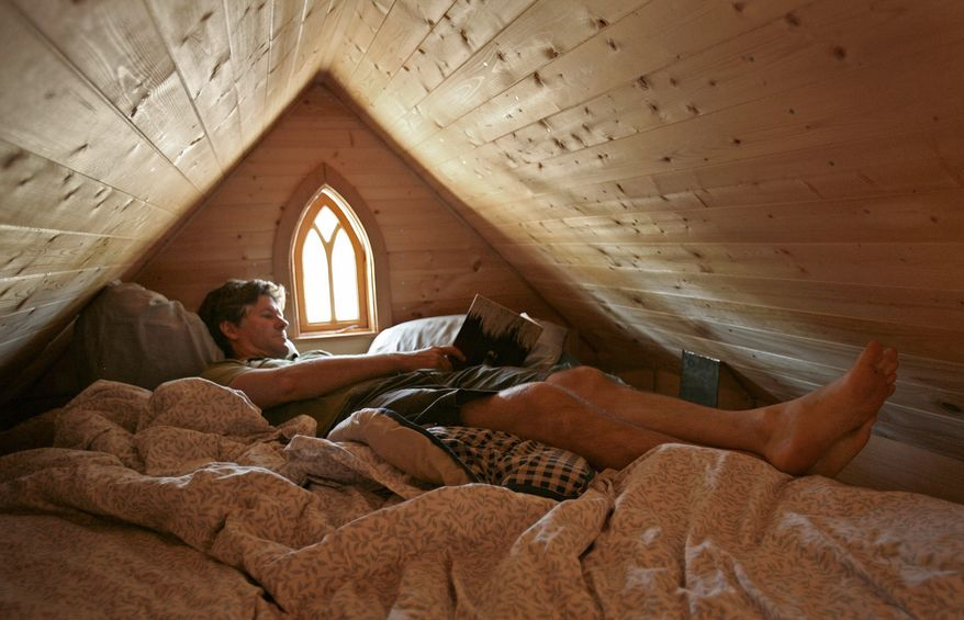 ASSOCIATED PRESS PHOTOGRAPHS Jay Shafer, owner of Tumbleweed Tiny House Co., says the 500-square-foot house he shares with his wife and son has all the space they need. He builds and sells tiny houses for $50,000 or less and sells about 50 blueprints a year for $1,000 or less.
