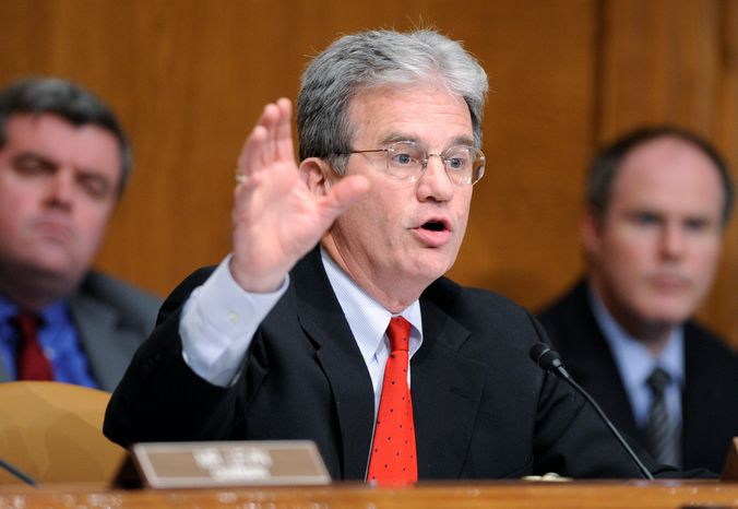 ** FILE ** The Senate investigations subcommittee's ranking Republican, Sen. Tom Coburn, questions a witness on Capitol Hill in Washington on Tuesday, April 27, 2010, during the subcommittee's hearing on Goldman Sachs a