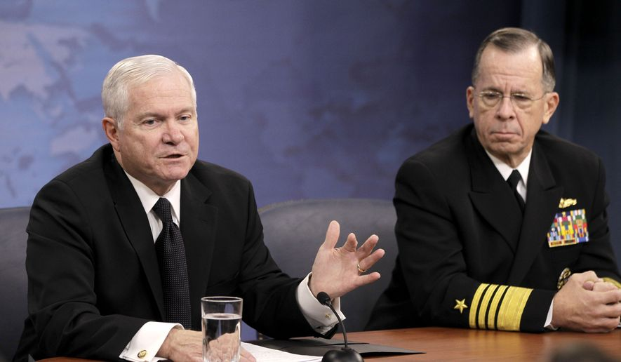 Defense Secretary Robert M. Gates and Adm. Mike Mullen, chairman of the Joint Chiefs of Staff, speak to reporters on gays in the military on Tuesday, Nov. 30, 2010, at the Pentagon. (AP Photo/Charles Dharapak)