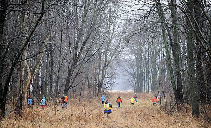 """Volunteers and rescuers search for 9-year-old Andrew, 7-year-old Alexander and 5-year-old Tanner Skelton in Morenci, Mich. on Tuesday, Nov. 30, 2010. Authorities """"do not anticipate a positive outcome"""" in the search for three Michigan brothers who have been missing since their father's attempted suicide, a police chief said Tuesday. (AP Photo/The Detroit News, David Coates)"""