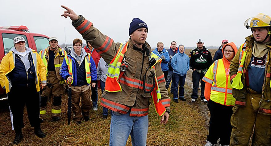 "Micah Borton, captain with the Morenci fire department directs volunteers and rescuers to various locations as the search for 9-year-old Andrew, 7-year-old Alexander and 5-year-old Tanner Skelton continues in Morenci, Mich. on Tuesday, Nov. 30, 2010. Authorities ""do not anticipate a positive outcome"" in the search for three Michigan brothers who have been missing since their father's attempted suicide, a police chief said Tuesday. (AP Photo/The Detroit News, David Coates)"