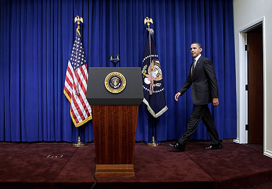 President Barack Obama arrives in the Eisenhower Executive Office Building, on the White House campus in Washington, Tuesday, Nov. 30, 2010, to make a statement to reporters about his meeting today with Republican and Democratic Congressional leaders.  (AP Photo/J. Scott Applewhite)