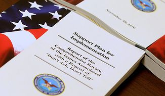 """A report of a Pentagon survey on the issues associated with a repeal of """"Don't Ask, Don't Tell"""" is seen on a table,at the Pentagon, Tuesday, Nov. 30, 2010, after Defense Secretary Robert Gates and Joint Chiefs Chairman Adm. Mike Mullen spoke to reporters on gays in the military.  (AP Photo/Charles Dharapak)"""