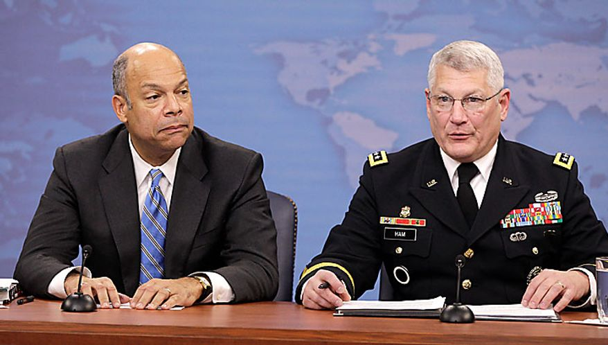 Pentagon General Counsel Jeh Johnson, left, and Army Gen. Carter Ham, speak to reporters on gays in the military, Tuesday, Nov. 30, 2010, at the Pentagon. (AP Photo/Charles Dharapak)