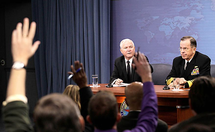 Defense Secretary Robert Gates, and Joints Chiefs Chairman Adm. Mike Mullen, speak to reporters on gays in the military, Tuesday, Nov. 30, 2010, at the Pentagon. (AP Photo/Charles Dharapak)