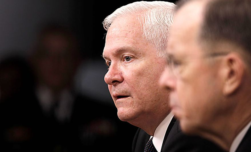Defense Secretary Robert Gates, left, and Joint Chiefs Chairman Adm. Mike Mullen, speak to reporters on gays in the military, Tuesday, Nov. 30, 2010, at the Pentagon. (AP Photo/Charles Dharapak)