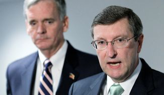 ASSOCIATED PRESS FOR IT: Sens. Kent Conrad (right), North Dakota Democrat, and Judd Gregg, New Hampshire Republican, the top two lawmakers on the president's deficit-reduction panel, endorsed its recommendations Wednesday.