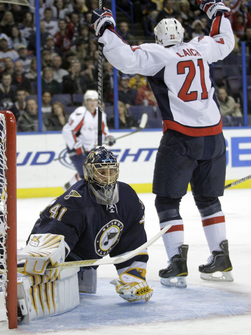 Washington Capitals' Brooks Laich (21) celebrates a goal as St. Louis Blues' Jaroslav Halak, of Slovakia, reacts in the first period of an NHL hockey game, Wednesday, Dec. 1, 2010 in St. Louis. (AP Photo/Tom Gannam)