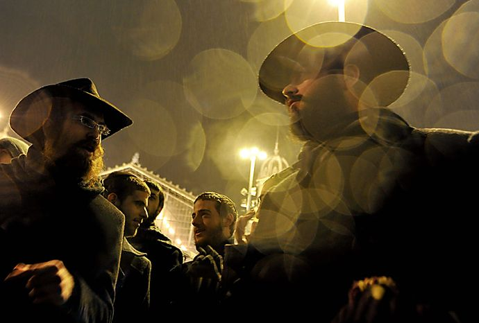 Members of the Hungarian Orthodox Jewish community dance at the beginning of the Hanukkah Festival in downtown Budapest, Hungary, Wednesday, Dec 1, 2010. The Hanukkah Festival, also known as the Festival of Lights, is lasting eig