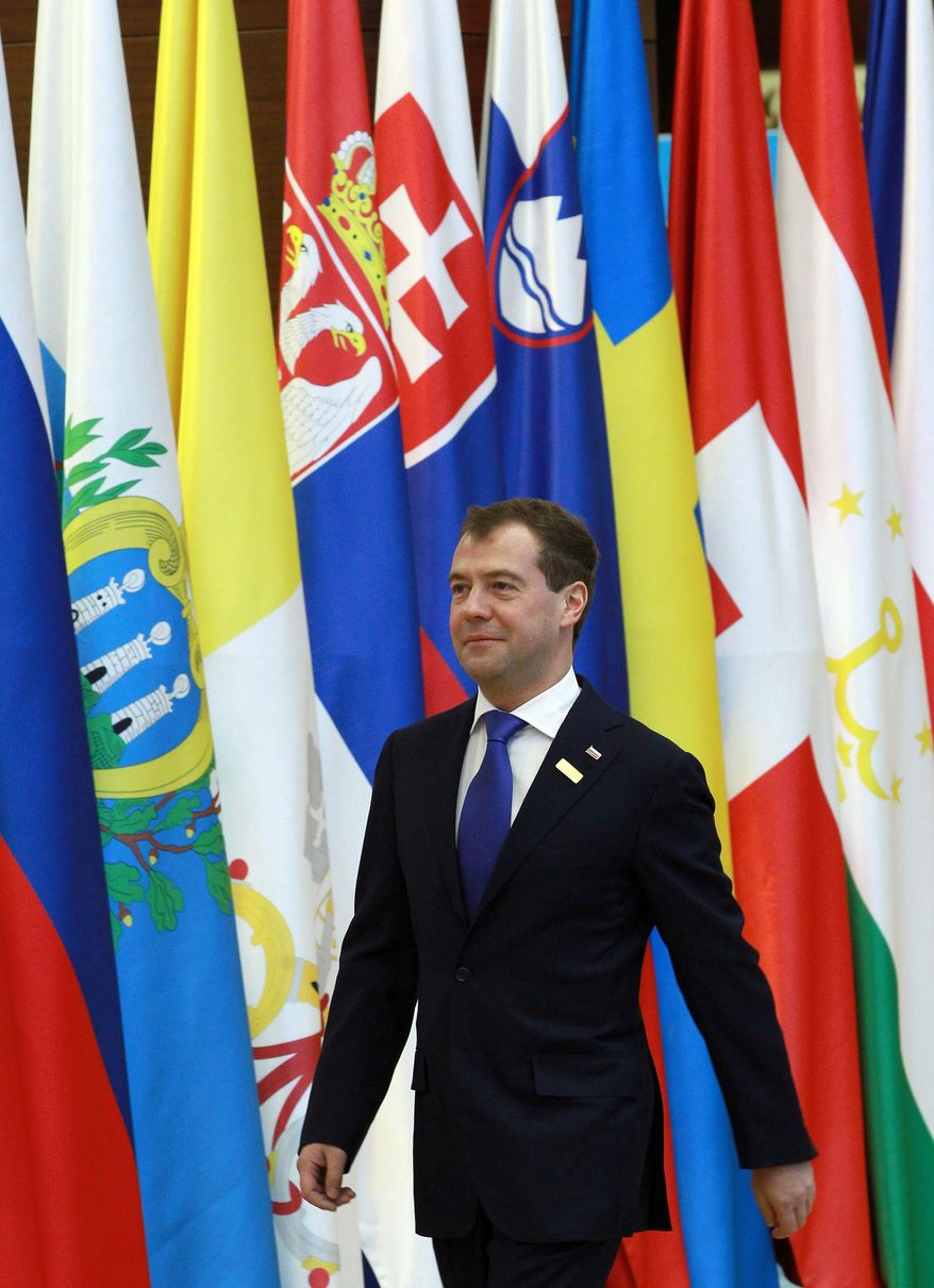Russian President Dmitry Medvedev walks in Astana, Kazakhstan's capital, at a start of OSCE (Organization for Security and Cooperation in Europe) meeting on Wednesday, Dec. 1, 2010. The group uniting the U.S., Europe and Central Asian nations is holding its first security summit in more than a decade, with Afghanistan and international terrorism high on the agenda. (AP photo/RIA Novosti/Vladimir Rodionov, Presidential Press service)