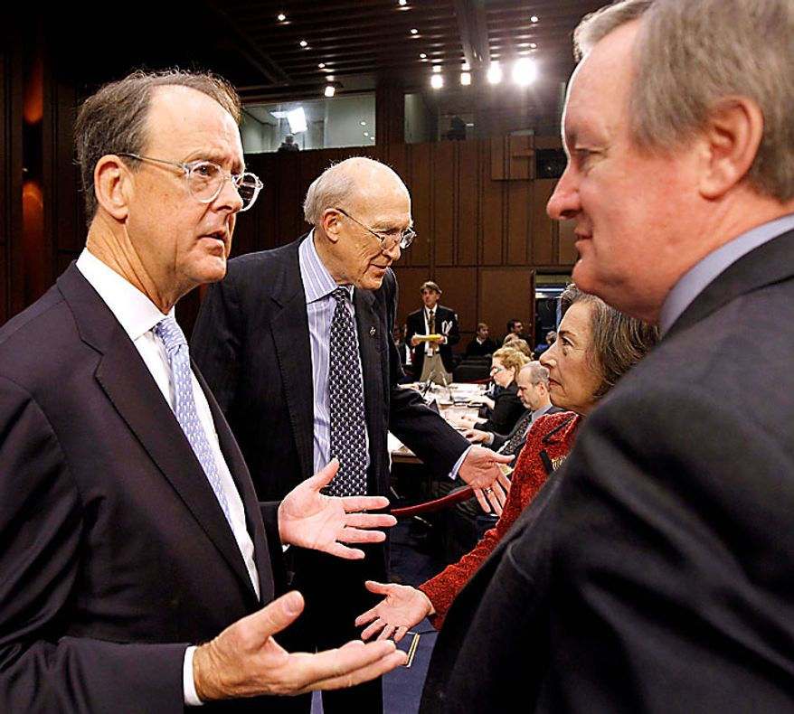 Debt Commission co-chairmen Erskine Bowles, left, and former Wyoming Sen. Alan Simpson, right, talk with other members Rep. Jan Schakowsky, D-Ill., and Sen. Mike Crapo, R-Idaho, on Capitol Hill in Washington Wednesday, Dec. 1, 2010, before a meeting of the commission .(AP Photo/Alex Brandon)