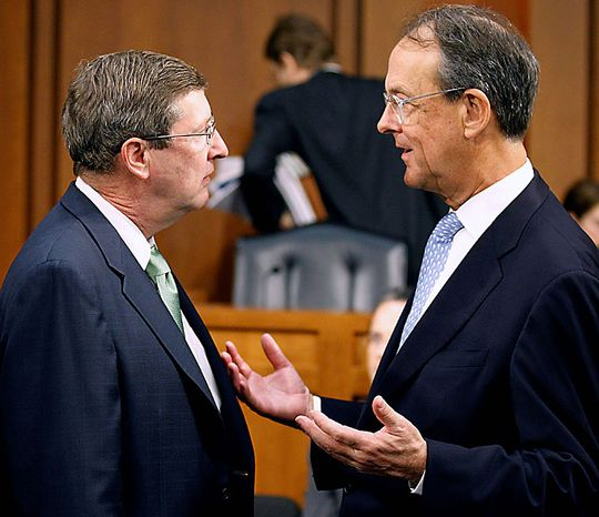Debt Commission member, Senate Budget Committee Chairman Sen. Kent Conrad, D-N.D., left , talks with co-chairmen Erskine Bowles, before a meeting of the commission on Capitol Hill in Washington, Wednesday, Dec. 1, 2010. (AP Photo/Alex Brandon)