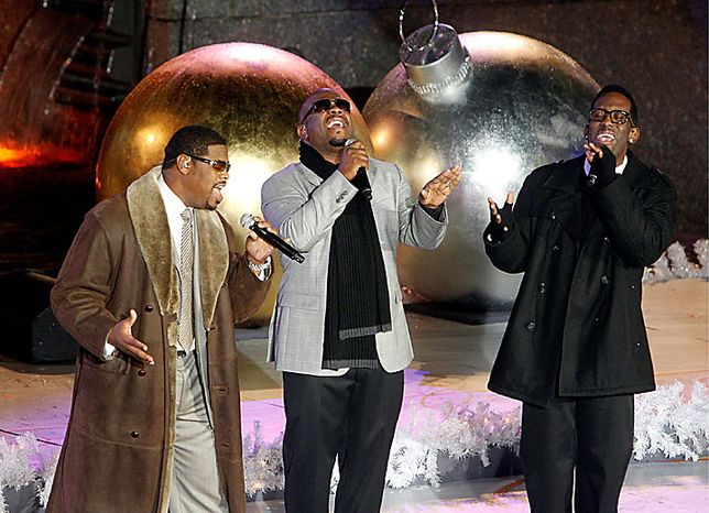 Members of the group Boyz II Men, from left, Nathan Morris, Wanya Morris and Shawn Stockman perform during the 78th annual Rockefeller Center Christmas tree lighting ceremony Tuesday, Nov. 30, 2010, in New York. (AP Photo/Jason DeCrow)