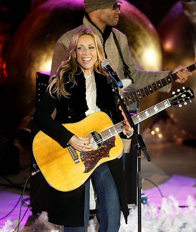 Singer Sheryl Crow performs during the 78th annual Rockefeller Center Christmas tree lighting ceremony Tuesday, Nov. 30, 2010, in New York. (AP Photo/Jason DeCrow)