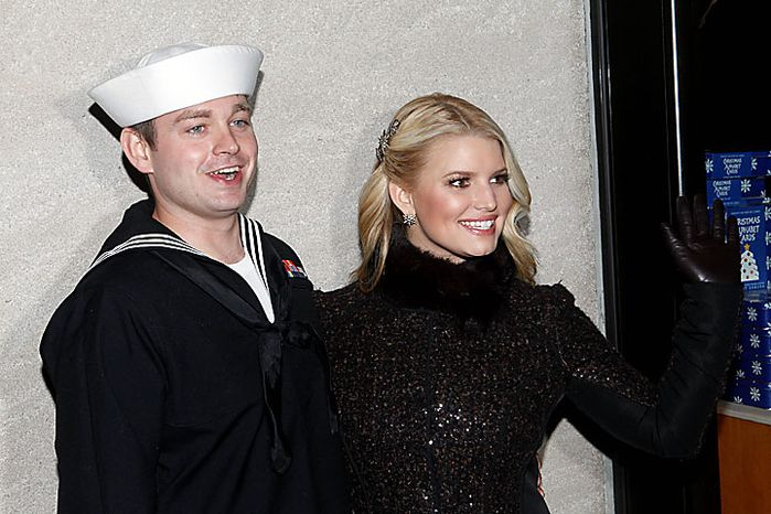 Singer Jessica Simpson poses with Petty Officer John Britt, of Memphis, Tenn., during the 78th annual Rockefeller Center Christmas tree lighting ceremony Tuesday, Nov. 30, 2010, in New York. (AP Photo/Jason DeCrow)
