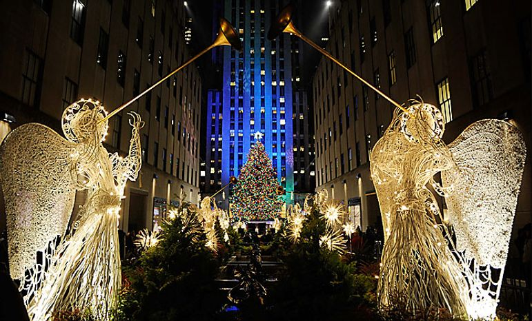 The Rockefeller Center Christmas tree stands lit during the 78th annual lighting ceremony Tuesday, Nov. 30 , 2010 in New York. (AP Photo/Stephen Chernin)