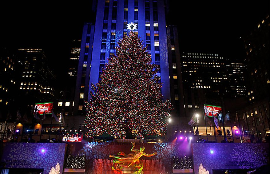 The Rockefeller Center Christmas tree stands lit during the 78th annual lighting ceremony Tuesday, Nov. 30, 2010, in New York. (AP Photo/Jason DeCrow)