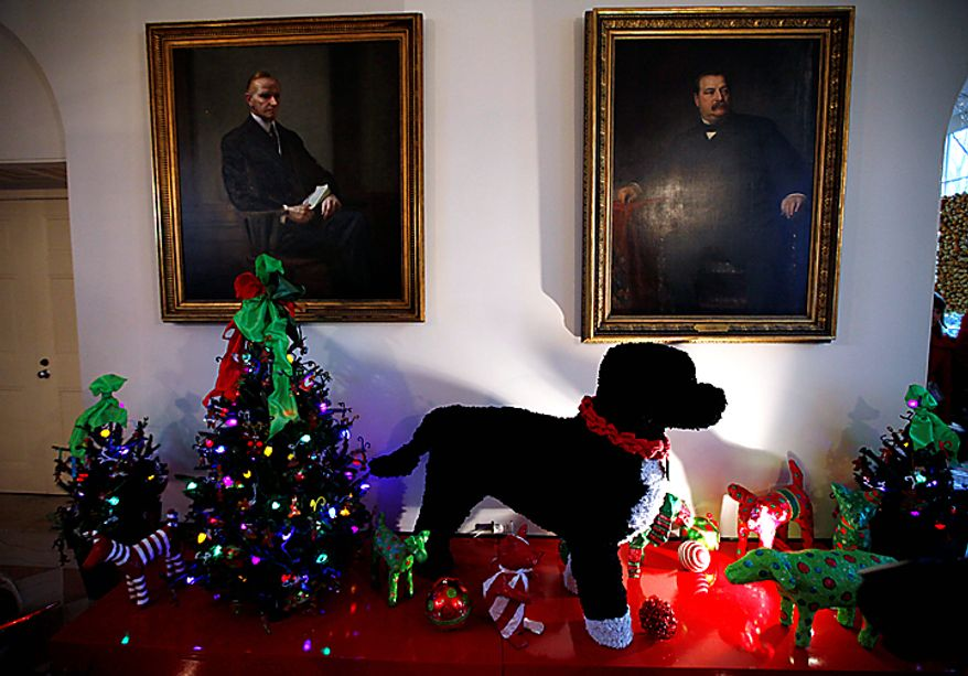 """An oversized version of Bo, the Obama family dog, made of pipe cleaners, is displayed in the Booksellers area of the White House in Washington, Wednesday, Dec. 1, 2010. The theme for the White House Christmas 2010 is """"Simple Gifts"""". (AP Photo/Charles Dharapak)"""