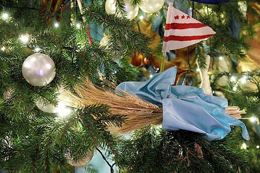 """Ornaments are seen on the official White House Christmas Tree in the Blue Room of the White House in Washington, Wednesday, Dec. 1, 2010. The theme for the White House Christmas 2010 is """"Simple Gifts"""".  (AP Photo/Charles Dharapak)"""