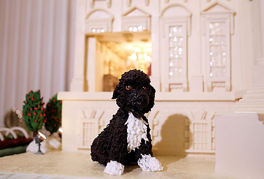 "The Obama family dog, Bo, made from marzipan, is seen as the 2010 White House Chocolate Gingerbread House is displayed in the State Dining Room of the White House in Washington, Wednesday, Dec. 1, 2010. The theme for the White House Christmas 2010 is ""Simple Gifts"". (AP Photo/Charles Dharapak)"