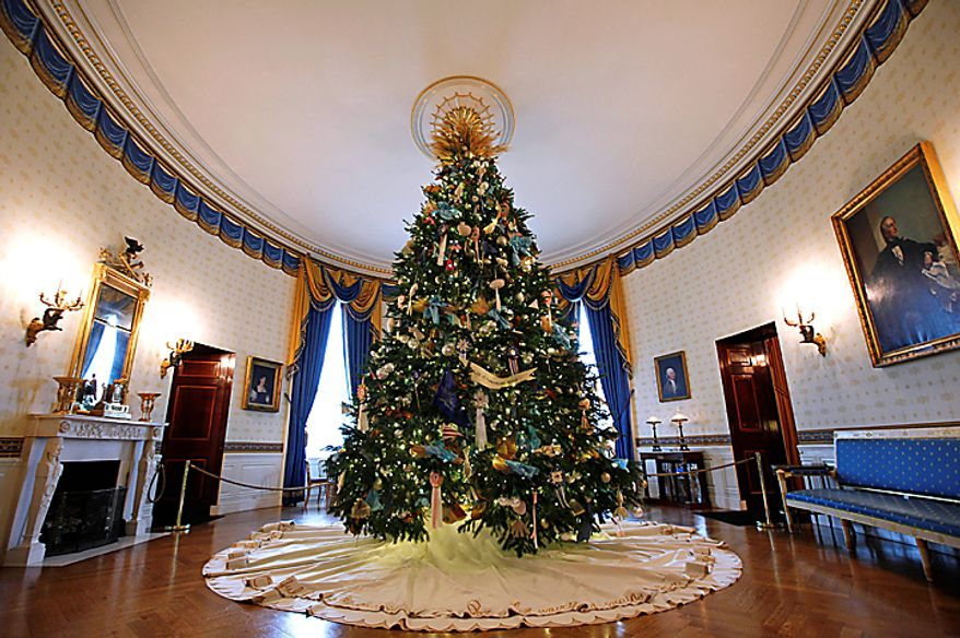 """The official White House Christmas Tree is seen in the Blue Room of  the White House in Washington, Wednesday, Dec. 1, 2010. The theme for the White House Christmas 2010 is """"Simple Gifts"""". (AP Photo/Charles Dharapak)"""
