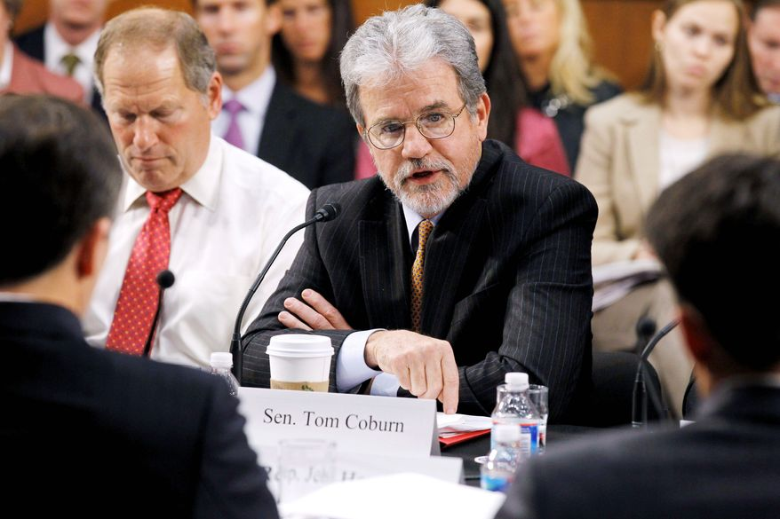 "IN SUPPORT: Sen. Tom Coburn, Oklahoma Republican, says that fiscally, ""We're at a day of reckoning."" (Associated Press)"
