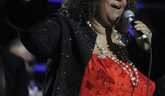 FILE - In this Oct. 30, 2009 file photo, Aretha Franklin performs at the 25th Anniversary Rock & Roll Hall of Fame concert at Madison Square Garden in New York. A community prayer vigil was held in Detroit for Aretha Franklin on Wednesday, Dec. 1, 2010, a day before organizers say the singing legend is to undergo a medical procedure. (AP Photo/Henny Ray Abrams, File)