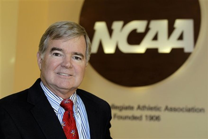 "FILE - In this file photo taken Oct. 7, 2010, NCAA President Mark Emmert speaks during the Indiana Sports Corporation annual meeting in Indianapolis. Emmert said in a statement on the NCAA's web site Thursday, Dec. 2, 2010, that his organization will ""work aggressively"" with member schools to change bylaws and avoid repeats of Auburn quarterback Cam Newton's situation. (AP Photo/Darron Cummings, File)"
