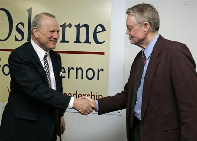 FILE - This Feb 22, 2006, file photo,  shows former Oklahoma football coach Barry Switzer, left, and former Nebraska football coach Tom Osborne, shaking hands in Lincoln, Neb. The upcoming Big 12 championship game between Oklahoma and Nebraska brings back memories of those Thanksgiving weekend battles between the Big Reds of the North and South. (AP Photo/Nati Harnik)