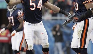 FILE - In this Nov. 28, 2010 file photo, Chicago Bears linebacker Brian Urlacher (54) reacts to a play with teammate Lance Briggs (55) during an NFL football game against the Philadelphia Eagles in Chicago. Between the wrist injury last year and the neck and back problems before that, there were all sorts of questions about Urlacher. Teammates, however, insist they had no doubts. Now, Urlacher is up to his old Pro Bowl tricks again for the Bears. (AP Photo/Nam Y. Huh, File)