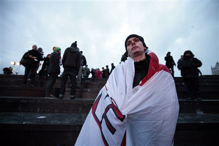 Fans of England's bid for the 2018 soccer World Cup, react after the announcement that Russia will host the tournament, in London, Thursday, Dec. 2, 2010. (AP Photo/Lefteris Pitarakis)