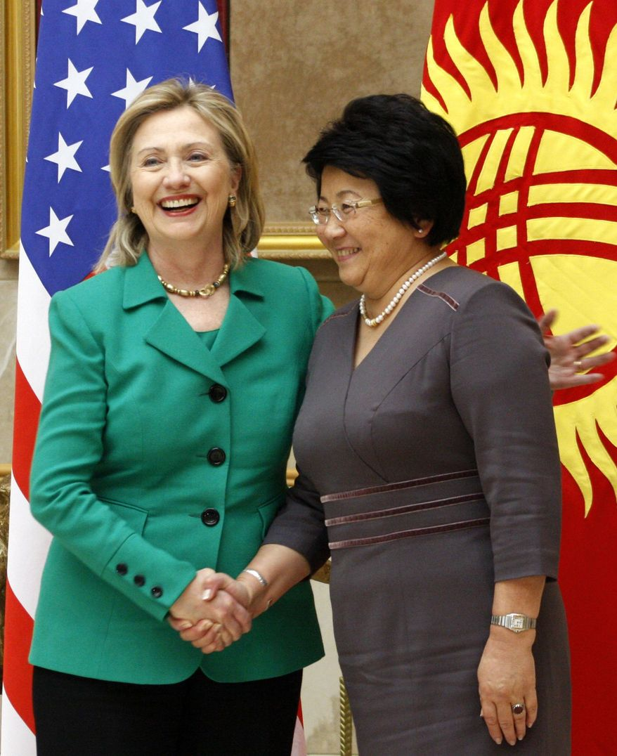 Secretary of State Hillary Rodham Clinton meets with Kyrgyzstan President Roza Otunbayeva (right) in Bishkek on Thursday, Dec. 2, 2010. The United States will reconsider its military presence in the Central Asian nation of Kyrgyzstan once it winds down its combat mission in Afghanistan in 2014, Mrs. Clinton said. (AP Photo/Nina Gorshkova)