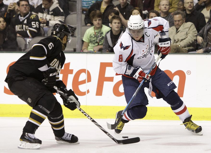 Dallas Stars defenseman Trevor Daley (6) defends as Washington Capitals left wing Alex Ovechkin (8) of Russia controls the puck in the second period of an NHL hockey game, Thursday, Dec. 2, 2010, in Dallas. (AP Photo/Tony Gutierrez)