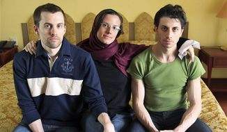 ** FILE ** American hikers Shane Bauer (left), Sarah Shourd and Josh Fattal are pictured at the Esteghlal Hotel in Tehran in May 2010. (AP Photo/Press TV, File)