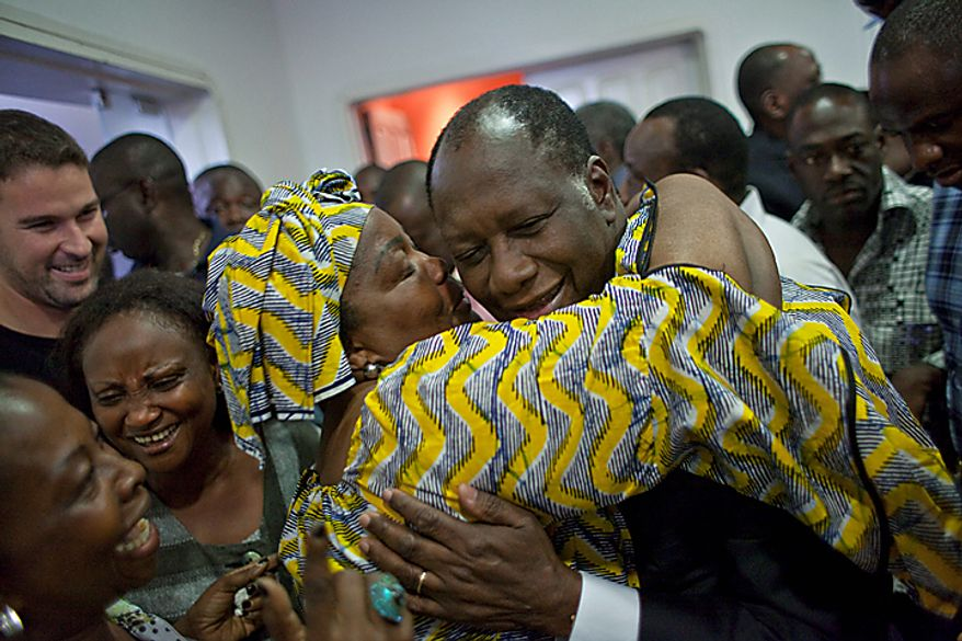 "Opposition leader Alassane Ouattara celebrates with relatives after the electoral commission head announced his victory in last Sunday's presidential run-off, in Abidjan, Ivory Coast, Thursday, Dec. 2, 2010. A senior advisor to Ivory Coast President Laurent Gbagbo has described the announcement of results by the country's electoral commission showing a victory for the opposition as ""an attempted coup.""(AP Photo/Thibault Camus)"