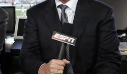 """FILE - This Sept. 14, 2009, file photo, shows ESPN broadcaster Jon Gruden before an NFL football game between the New England Patriots and the Buffalo Bills in Foxborough, Mass.  Gruden is saying again that he's committed to staying at ESPN. Gruden says he's """"very thankful"""" to have the job as an analyst on """"Monday Night Football,"""" and that he's sorry about all the speculation that's surrounded his future over the last few days. (AP Photo/Steven Senne, File)"""