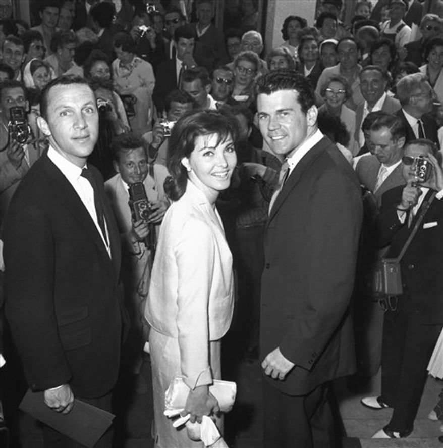 "FILE - In this May 1961 file photo, director Irvin Kershner, left, and actors Cindi Wood and Don Murray arrive at the Festival Palace at the Cannes Festival in Cannes, France, as their film ""Hoodlum Priest,"" was presented at the festival. The agent for Kershner says the director of the ""Star Wars"" sequel ""The Empire Strikes Back"" has died at age 87. Agent Derek Maki says in an e-mail to The Associated Press on Monday, Nov. 29, 2010, that Kershner died during the weekend, but no further details are available. (AP Photo, File) NO SALES"