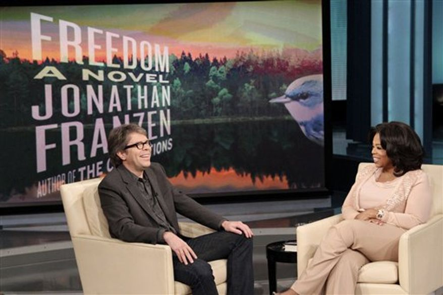 "This photo taken Nov. 19, 2010 and provided by Harpo Productions Inc., shows best-selling author Jonathan Franzen and talk-show host Oprah Winfrey during taping of ""The Oprah Winfrey Show"" at Harpo Studios in Chicago. Franzen's book ""Freedom"" is Winfrey's 64th Book Club selection. The show will air nationally Monday, Dec. 6. (AP Photo/Harpo Productions Inc., George Burns)  NO SALES"
