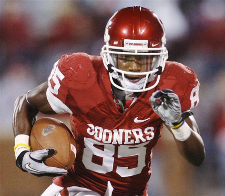 FILE - In this Oct. 30, 2010 file photo, Oklahoma wide receiver Ryan Broyles carries the ball against Colorado during an NCAA college football game in Norman, Okla. He's not even the best receiver in the conference but it'd be hard to find another one better than Broyles. He leads the nation in catches with 115 for 1,391 yards. (AP Photo/Sue Ogrocki,File)