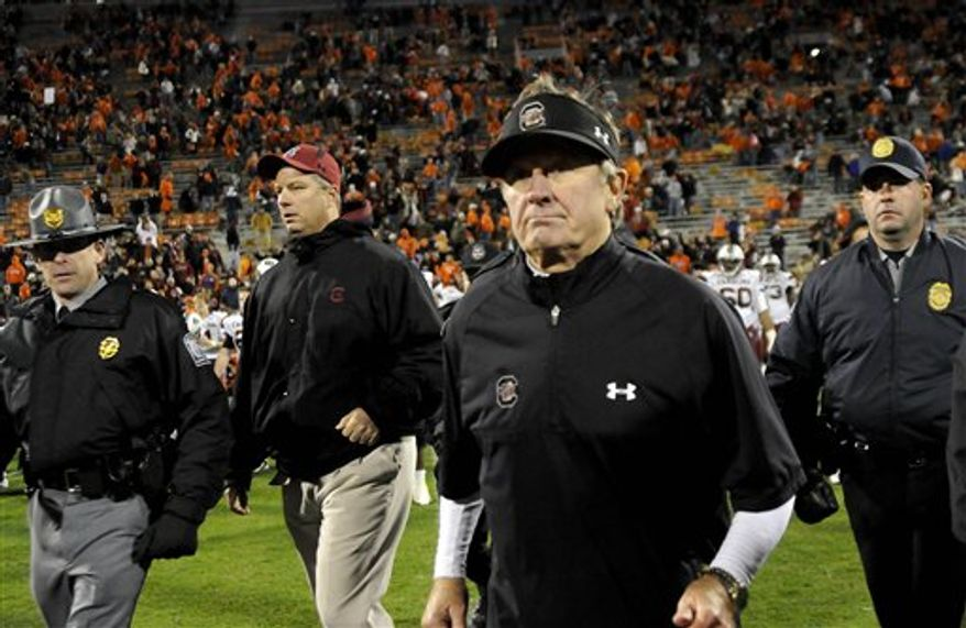 South Carolina head coach Steve Spurrier, second from right, crosses the field at the end of an NCAA college football game against Clemson, Saturday Nov. 27, 2010 at Memorial Stadium in Clemson S.C. South Carolina won 29-7. (AP Photo/ Richard Shiro)