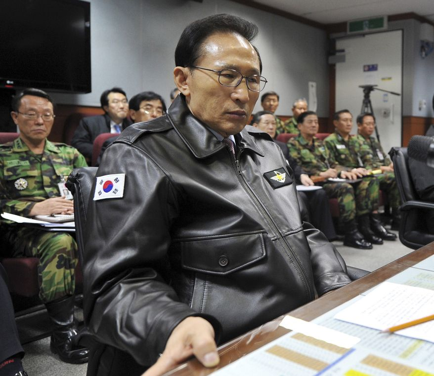 ** FILE ** South Korean President Lee Myung-bak has a briefing with the Joint Chiefs of Staff in Seoul on Tuesday, Nov. 23, 2010, as the military was put on top alert after North Korea's artillery attack on the South Korean island of Yeonpyeong. (AP Photo/Yonhap, File)