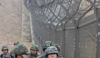 Gen. Hwang Eui-don, chief of the General Staff of the South Korean Army (right), patrols with soldiers along the fence of the Demilitarized Zone between the two Koreas in Paju, South Korea, on Wednesday. (AP Photo/Korea Pool)