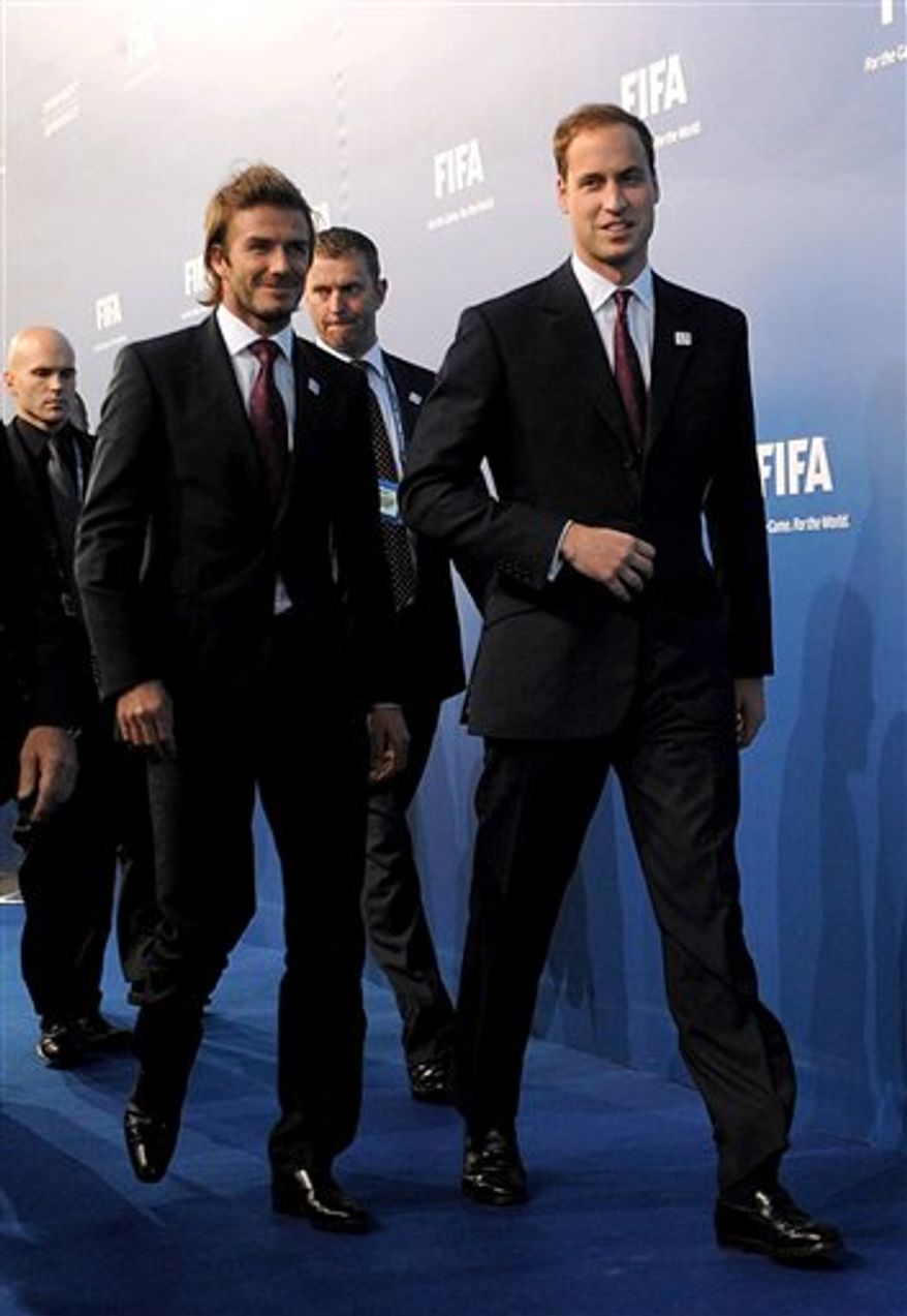 David Beckham, left,  and Prince William arrive for the announcement on which countries will host the 2018 and 2022 soccer World Cups at the Zurich Exhibition Center, Zurich, Switzerland Thursday Dec. 2, 2010.  England, Russia, and joint bids from Belgium-Netherlands and Spain-Portugal are vying for the 2018 World Cup. (AP Photo/Anthony Devlin/PA Wire)  UNITED KINGDOM OUT NO SALES NO ARCHIVE