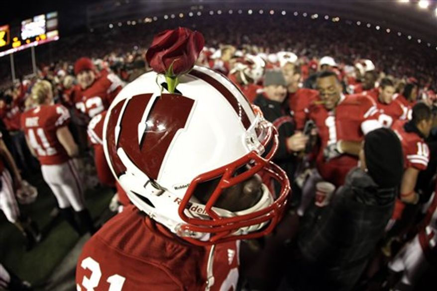 FILE - In this Nov. 27, 2010, file photo, Wisconsin cornerback Josh Peprah wears a rose in his helmet after beating Northwestern 70-23 in an NCAA college football game in Madison, Wis. Wisconsin believes it's done plenty to reach the Rose Bowl and might even have a slim opportunity to reach the BCS national title game. (AP Photo/Morry Gash, File)