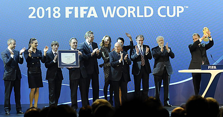 The delegates from Russia celebrate after winning hosting the 2018 Soccer World Cup  Thursday, Dec.  2, 2010 in Zurich, Switzerland. (AP Photo/Keystone, Walter Bieri)