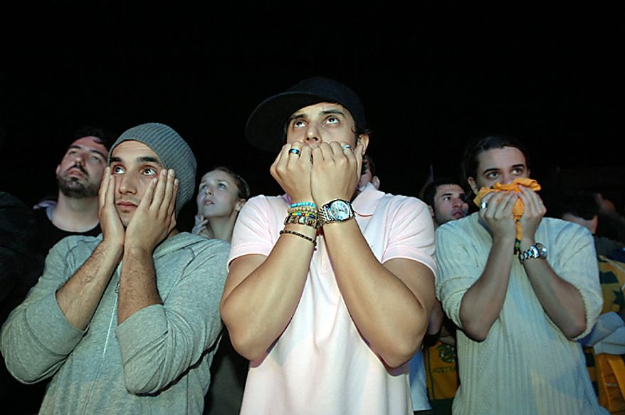 Australian's wait in the early hours of the morning at a live outdoor screening of the announcement of winners of the  2022 FIFA World Cup, Sydney, Friday, Dec.3, 2010. Australian lost its bid to host the 2022 event to the winning country, Qatar. (AP Photo/Jeremy Piper)