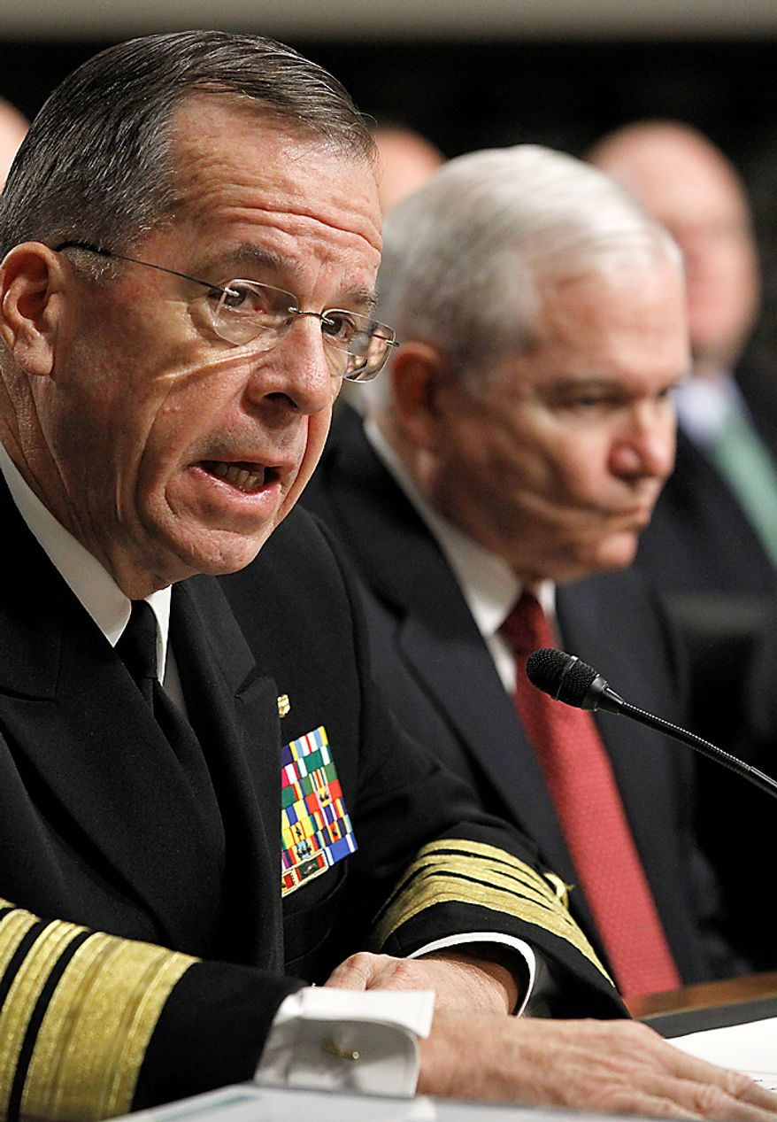 Joint Chiefs Chairman Adm. Michael Mullen, left, accompanied by Defense Secretary Robert Gates, on Capitol Hill in Washington Thursday, Dec. 2, 2010, before the Senate Armed Services Committee's  Don't Ask Don't Tell policy hearing. (AP Photo/Alex Brandon)