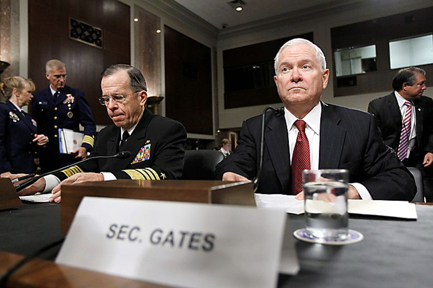 Defense Secretary Robert Gates, right, and Joint Chiefs Chairman Adm. Michael Mullen, take their seats on Capitol Hill in Washington Thursday, Dec. 2, 2010, prior to testifying before the Senate Armed Services Committee's Don't Ask Don't Tell policy hearing. (AP Photo/Alex Brandon)
