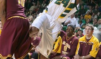 Baylor's LaceDarius Dunn, right, shoots a three-point shot past Arizona State's Jamelle McMillan, left, in the second half of an NCAA college basketball game Thursday, Dec. 2, 2010, in Waco, Texas. No. 11 Baylor won 68-54. (AP Photo/Waco Tribune Herald, Rod Aydelotte)